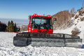 Red snowcat in mountains of Kazakhstan in ski resort Royalty Free Stock Photo