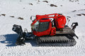 Red Snowcat travels on snow Royalty Free Stock Photo
