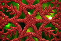 Red snowflake on green blurred background Royalty Free Stock Image