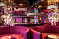 Red sofa in bar interior on cruise liner. Royalty Free Stock Photo