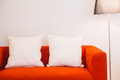 Red sofa with pillow and light lamp Royalty Free Stock Photo