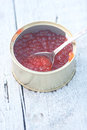 Red soft caviar in the can on snowbound board Royalty Free Stock Photography