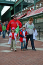 Red sox fans in fenway park in boston usa apr on april is the oldest professional sports venue the united states celebrating Royalty Free Stock Photos