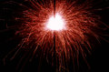 Red sparkler an ignited on a dark background Stock Photography