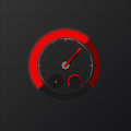 Red speedometer on carbon background