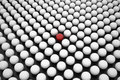Red Sphere between Array of White Spheres Royalty Free Stock Image