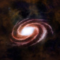 Red spiral galaxy against black space