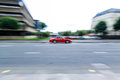 Red sport car moving fast, panning Royalty Free Stock Photo