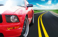 Red sport car on a narrow road Royalty Free Stock Photo