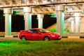 Red sport car under the brige with lights Stock Images