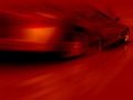 Red Sports Car in motion Stock Image