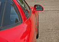 Red Sports Car Side View Royalty Free Stock Photo