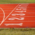 Red sports track with 8 lanes Royalty Free Stock Photography