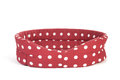 Red spotted empty pet bed Stock Photo
