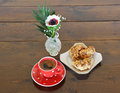 Red spotty mug and cookies vase with anemone Stock Image