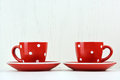Red spotty mugs on white background Stock Images