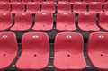 Red stadium grandstand empty plastic chairs of color on grandstands Stock Image