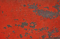 Red stained rusty painted metal surface with flakes