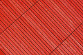Red stained timber slats viewed diagonally to create abstract pattern background Royalty Free Stock Photo