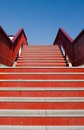 Red stairs the upwards metal to bridge Royalty Free Stock Image