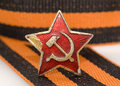 Red star of red army and st george ribbon are the symbols victory the ussr and in the second world war over nazi germany Royalty Free Stock Photo