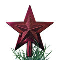 Red star on top of Christmas tree Royalty Free Stock Photo