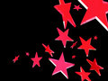 Red stars on black background Royalty Free Stock Image