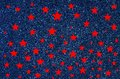 Red stars on blue glitter background Royalty Free Stock Photo