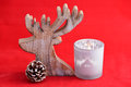 Red still life background with grey, white wooden reindeer Christmas decoration Royalty Free Stock Photo