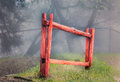 Red stockade fence in forest isolated fog Stock Image