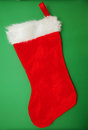 Red stocking christmas on green background Royalty Free Stock Photos