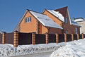 Red stone country house in winter Royalty Free Stock Photo