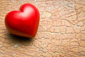 Red stone heart on old cracked background Royalty Free Stock Image