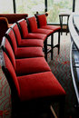 Red Stool Chairs in curve row Stock Photography