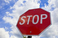Red stop sign on the street, roadside traffic  for stopping. Royalty Free Stock Photo