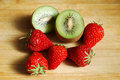 Red strawberry and kiwi on a chopping board very fresh Royalty Free Stock Photos