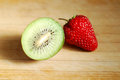 Red strawberry and kiwi on a chopping board very fresh Royalty Free Stock Photo