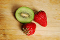 Red strawberry and kiwi on a chopping board very fresh Royalty Free Stock Photography