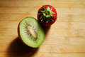 Red strawberry and kiwi on a chopping board very fresh Stock Image