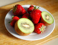 Red strawberry and kiwi in plate very fresh Royalty Free Stock Photos