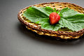 Red strawberry leaves wooden plate Royalty Free Stock Images