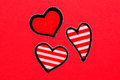 Red and striped hearts valentines day background with Stock Photos