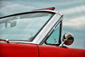 Red stylish car beautiful vintage on the exhibition with cloudy sky Royalty Free Stock Images