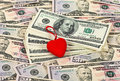 Red stylized heart on the money Royalty Free Stock Image