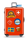 Red suitcase for travel with stickers Royalty Free Stock Photo