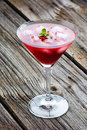 Red summer martini drink with mint on wooden top background Stock Image
