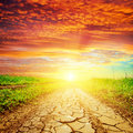 Red sunset over drought road good Royalty Free Stock Photo