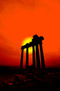 Red sunset over remains ancient greek temple sea Stock Photography