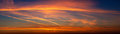 Red sunset summer sky panorama Stock Photos