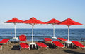 Red sunshades on the beach Royalty Free Stock Photo